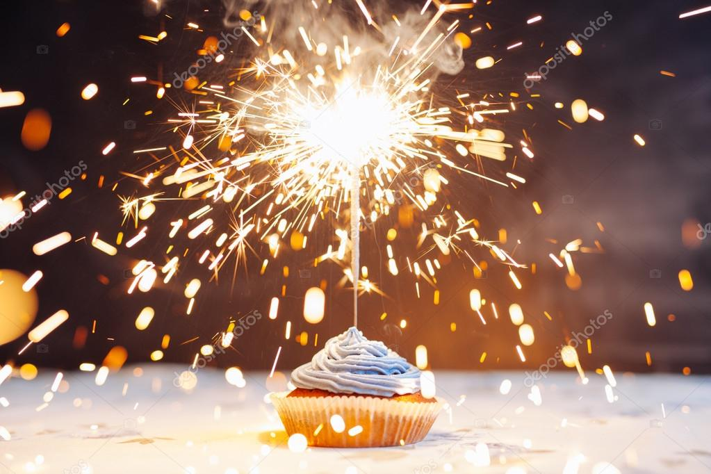 depositphotos_105012382-stock-photo-birthday-cupcake-with-a-sparkler.jpg