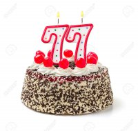 32579630-Birthday-cake-with-burning-candle-number-77-Stock-Photo.jpg